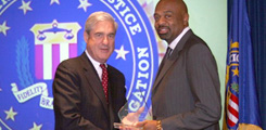 Justice James Graves and FBI Director Robert Mueller